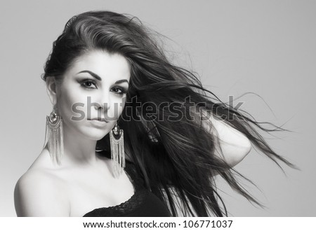 portrait of a young beautiful woman with brown hair looking