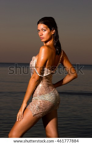 Portrait of a young beautiful woman with long hair on the beach
