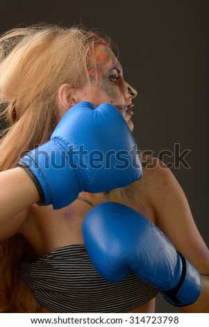 Portrait of a young beautiful woman with stylish make-up art, boxing, fight