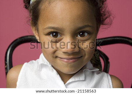 Portrait of a young Black girl sitting in a chair