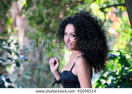 Portrait of a young black woman in the park - stock photo
