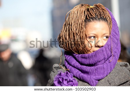 portrait of a young black woman with lilac scarf