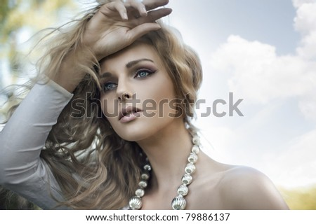 Portrait of a young blond beauty - stock photo