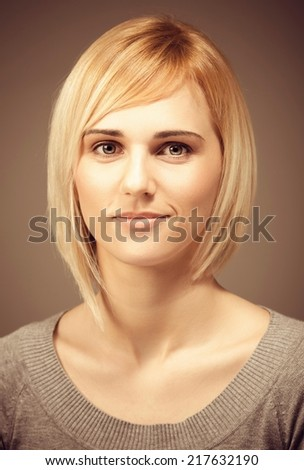 Portrait of a young blond woman smiling. - stock photo