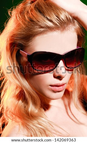 Portrait of a young blonde girl in sunglasses-closeup