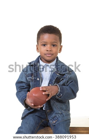 Portrait of a young boy holding a football