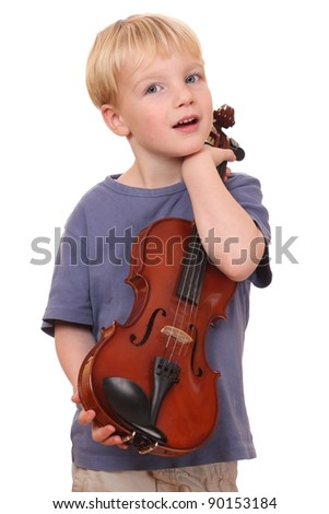 Portrait of a young boy holding his violin - stock photo