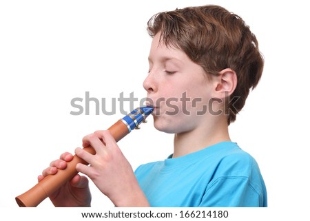 Portrait of a young boy playing the flute on white background - stock photo