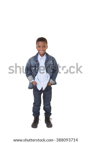 Portrait of a young boy standing isolated on white - stock photo