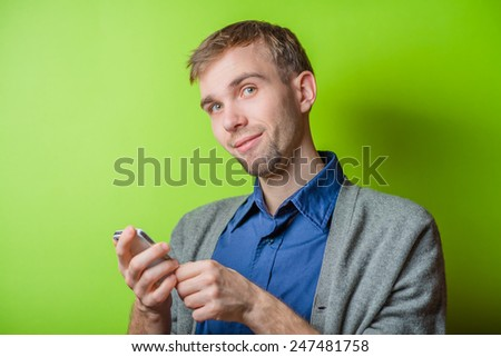 Portrait of a young boy text messaging on mobile phone  - stock photo