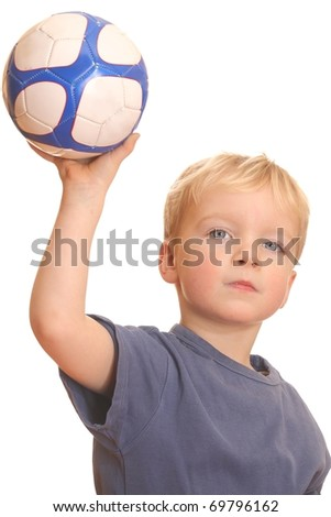 Portrait of a young boy throwing a ball - stock photo