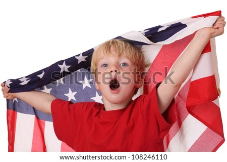 Portrait of a young boy with an american flag on white background - stock photo