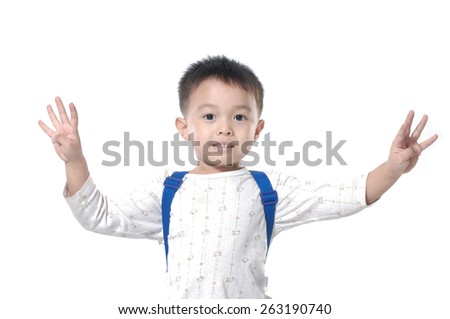 Portrait of a young boy with hand raised up against - stock photo