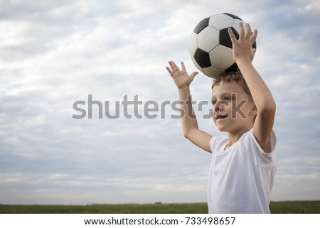 Portrait of a young  boy with soccer ball. Concept of sport.