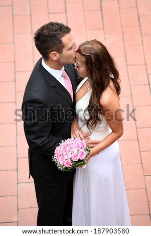Portrait of a young bride and groom - stock photo