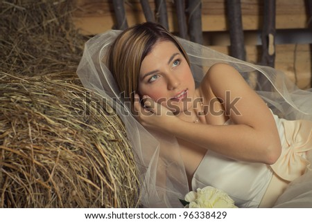 portrait of a young bride in the village studio