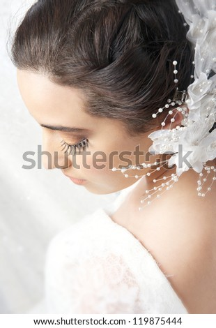 Portrait of a young bride looking down. - stock photo