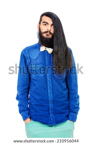Portrait of a young brunet man with a beard and long haired. Hairstyle. Isolated over white.