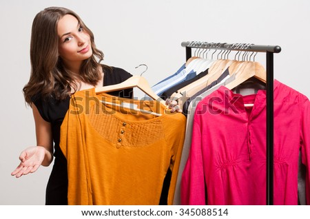 Portrait of a young brunette beauty having shopping fun.