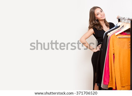 Portrait of a young brunette beauty having shopping fun. - stock photo