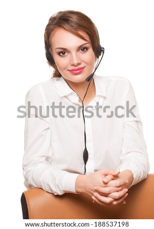 Portrait of a young brunette beauty wearing headset. - stock photo