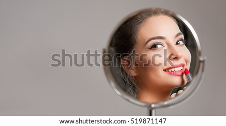 Portrait of a young brunette cosmetics beauty.