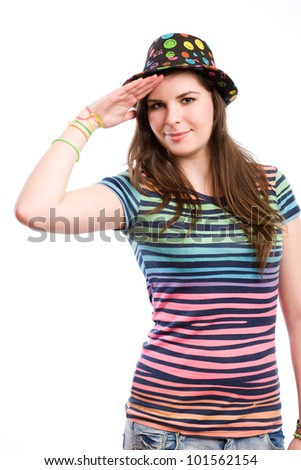 Portrait of a young brunette girl in colorful clothes doing funny salute.