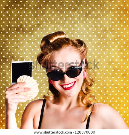 Portrait Of A Young Brunette Retro Pinup Girl Advertising Holidays And Travel Pics On Dotted Copyspace Background - stock photo
