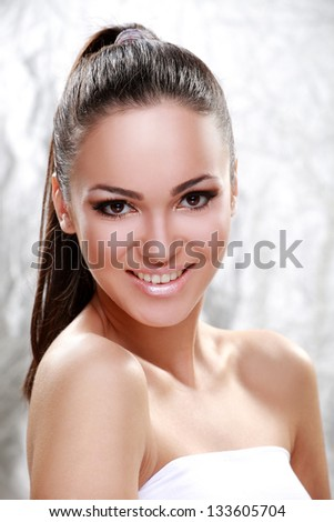 Portrait of a young brunette with beautiful smile