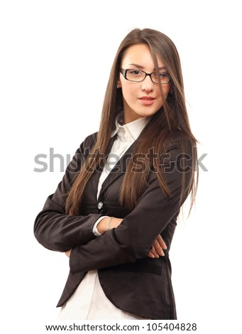 Portrait of a young business lady standing with folded hand against white background - stock photo