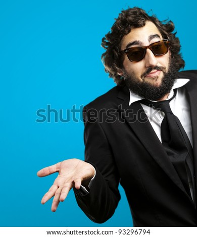 portrait of a young business man confused against a blue background - stock photo