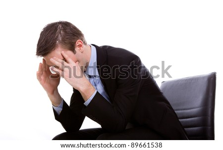 Portrait of a young business man depressed from work against white background - stock photo