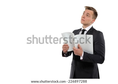 Portrait of a young business man holding journal and thinking.  - stock photo