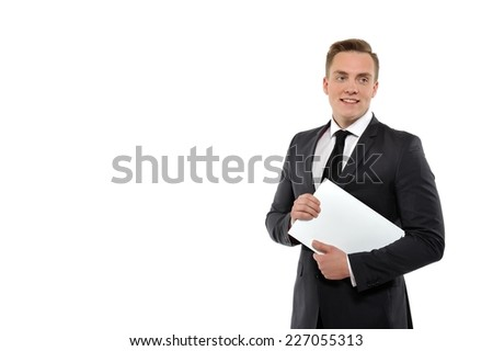 Portrait of a young business man holding journal. Isolated on white background.