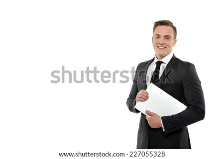 Portrait of a young business man holding journal. Isolated on white background. - stock photo