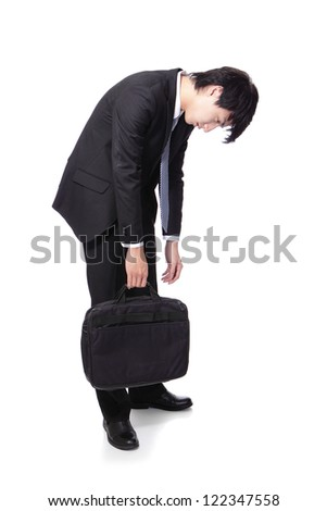 Portrait of a young business man looking depressed from work in full length isolated over white background, asian male model - stock photo