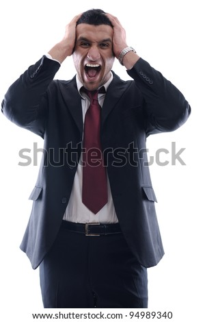 Portrait of a young business man looking depressed from work isolated over white background in studio - stock photo