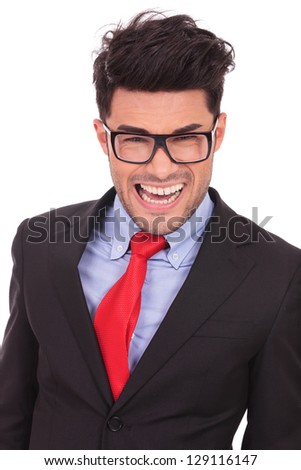 portrait of a young business man making a crazy smile, isolated on white