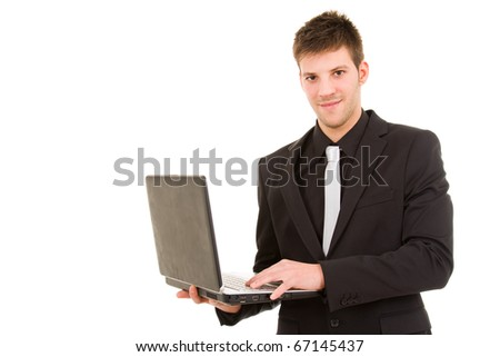 Portrait of a young business man standing with laptop against white background - stock photo