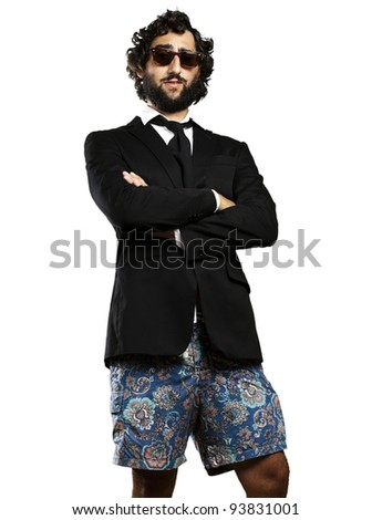 portrait of a young business man wearing a swimsuit against a white background