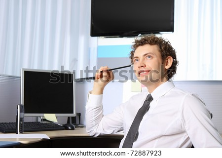 Portrait of a young business man working at office