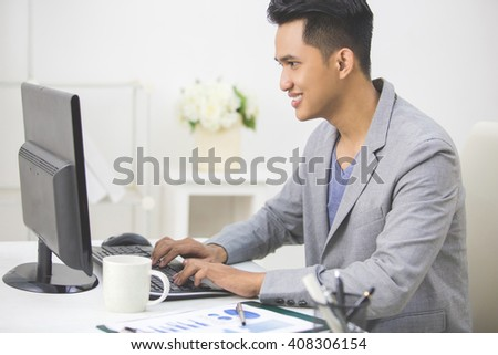 Portrait of a young business owner sitting on his office