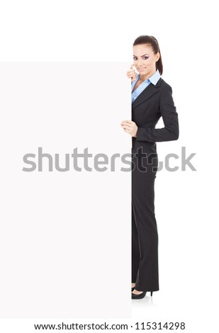 portrait of a young business woman holding a banner and smiling at the camera over white background - stock photo