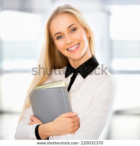 Portrait of a young business woman in an office - stock photo