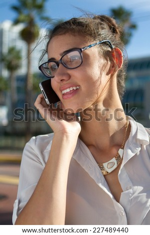 Portrait of a young business woman in the city. - stock photo