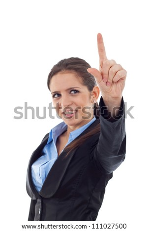 Portrait of a young business woman pushing an imaginary button. Isolated on white background. - stock photo