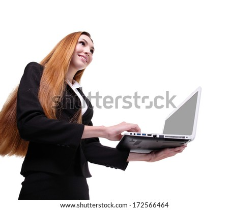 Portrait of a young business woman using laptop isolated on white background, low angle view - stock photo