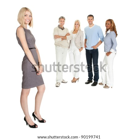 Portrait of a young business woman with her team of business people at the back - stock photo