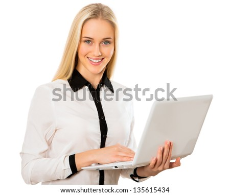 Portrait of a young business woman with laptop - stock photo