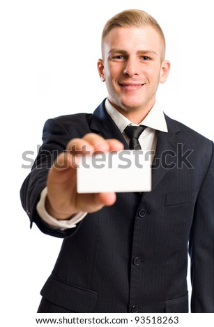 Portrait of a young businessman holding out a blank business card.